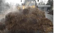 bulldozer scooping up biomass